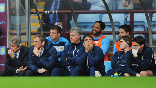 Anxious times - City's bench watched with bewilderment as the team went down 3-2 at Villa. Courtesy @MCFC