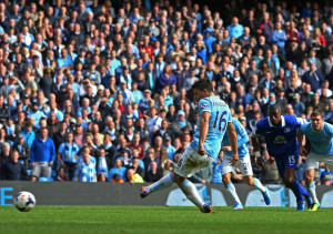 On its way - Sergio's penalty en-route past Tim Howard