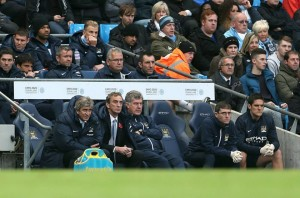 Bench time - Joe Hart watches the birdies - Canaries actually - get crushed Courtesy of MCFC
