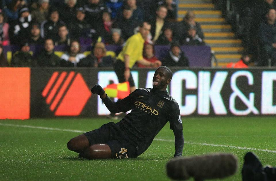 Sliding in to 2014 -Yaya celebrates his goal  Courtesy @MCFC