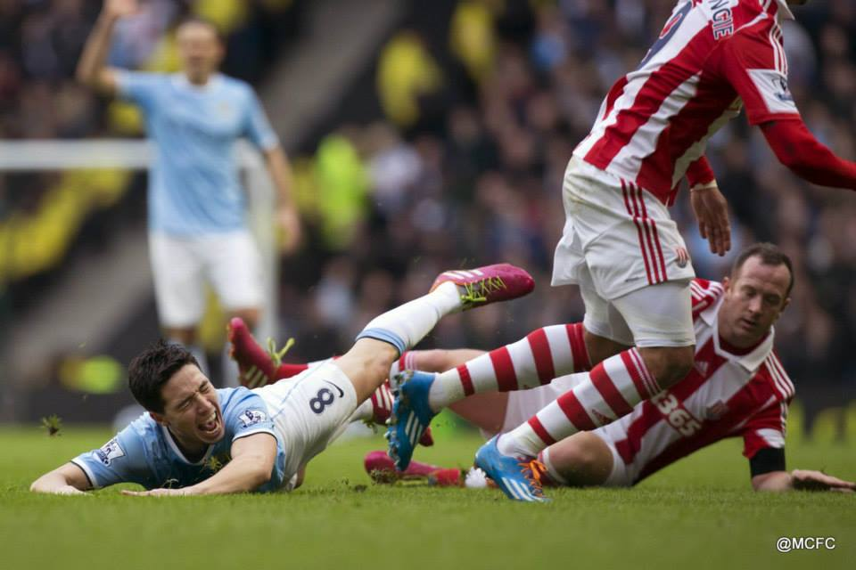 Proper Charlie - Stoke's Charlie Adam's has been earning rave reviews recently but he reverted to type when scything Nasri down  Courtesy @MCFC