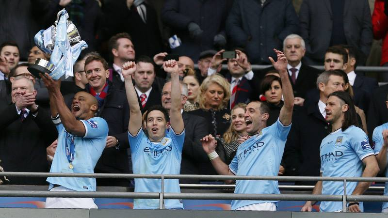 Blue Ribbon Event - Kompany lifts the League Cup aloft after City's 38 year wait  Courtesy @MCFC