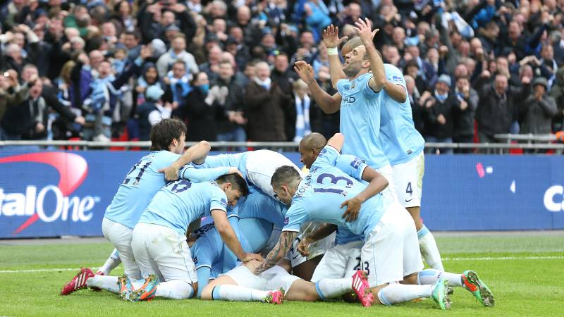 Jubilations - City players pile in, as they pile up a winning League Cup lead  Courtesy @MCFC