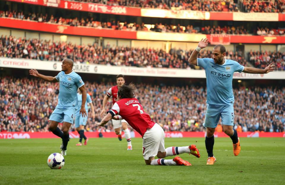 Dive dive dive - Rosicky should have seen yellow and ultimately red. Courtesy @MCFC