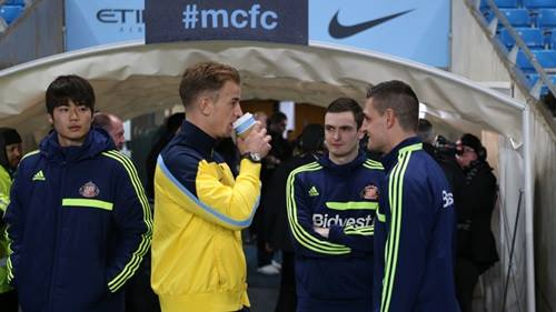 Pre-match chat but no combat - Joe Hart with ex-City winger Adam Johnson before the February fixture was postponed due to stormy weather. Courtesy @MCFC