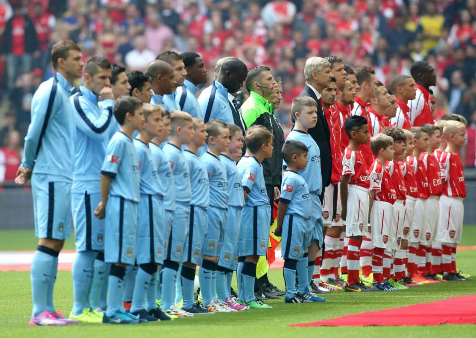 Calm before the storm - City and Arsenal line up for the Community Shield encounter. Courtesy@MCFC