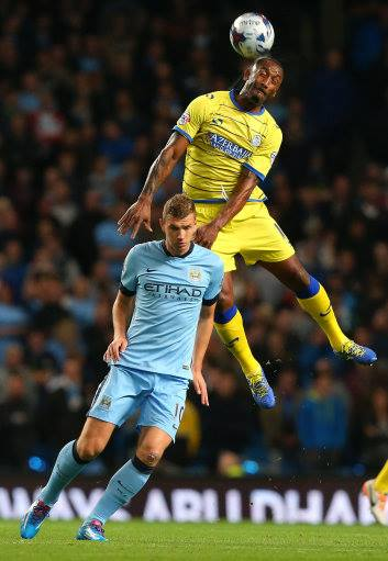 Brace yourself - Edin hit two goals on the night to get his season off the mark. Courtesy@MCFC