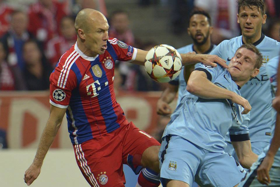 Dive dive dive - Robben prepares to go to ground challenged ny James Milner in Munich. Courtesy@MCFC