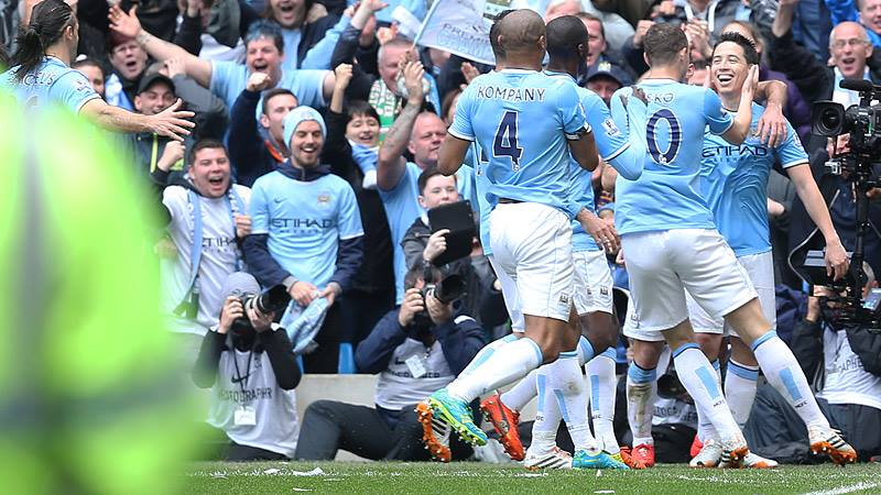 Happy days - City celebrate the opening goal in their 2-0 win as they clinch the title back in May. Courtesy@MCFC