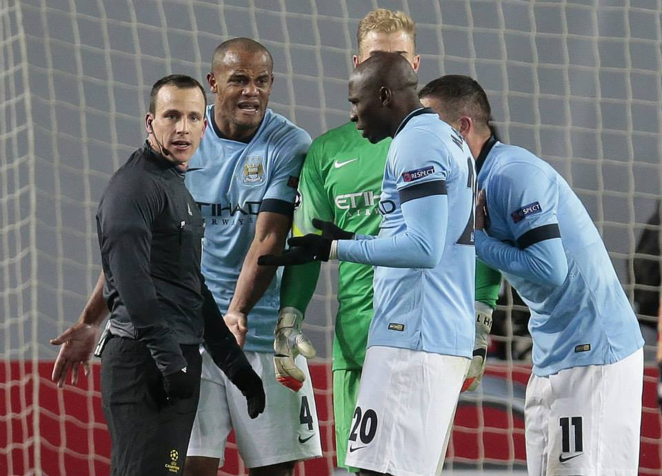 Russian revolt - Furious City players surround Istvan Vad, the bad referee from Hungary. Courtesy@MCFC