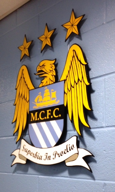 Play for the badge - City's eagle sits proudly on the dressing room wall.