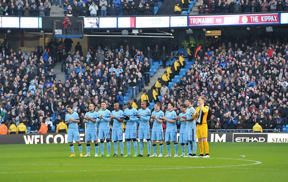 New Year honours - City players and supporters pay their pre-kick off respects to those associated with the Club who died during 2014. Courtesy@MCFC