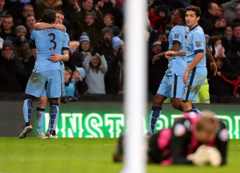 Sign him up - James Milner celebrates his FA Cup winner over Sheffield Wednesday with Gael Clichy. Courtesy@MCFC