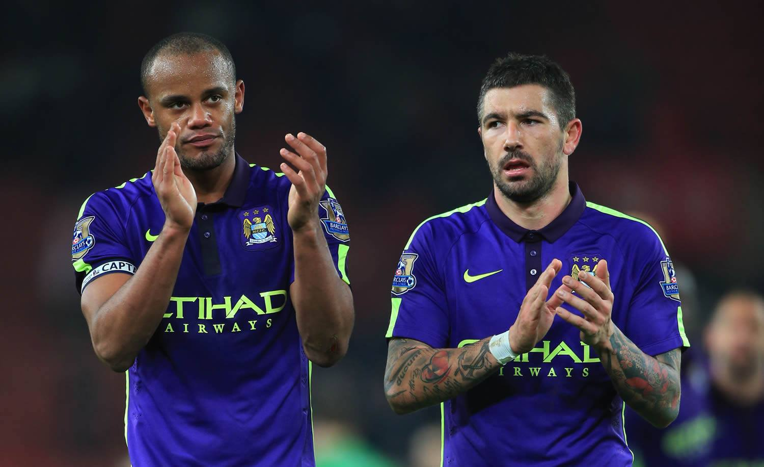 Saluting the City support - Kompany and Kolarov acknowledge the large and vocal City contingent on a cold night at the Britannia. Courtesy@MCFC