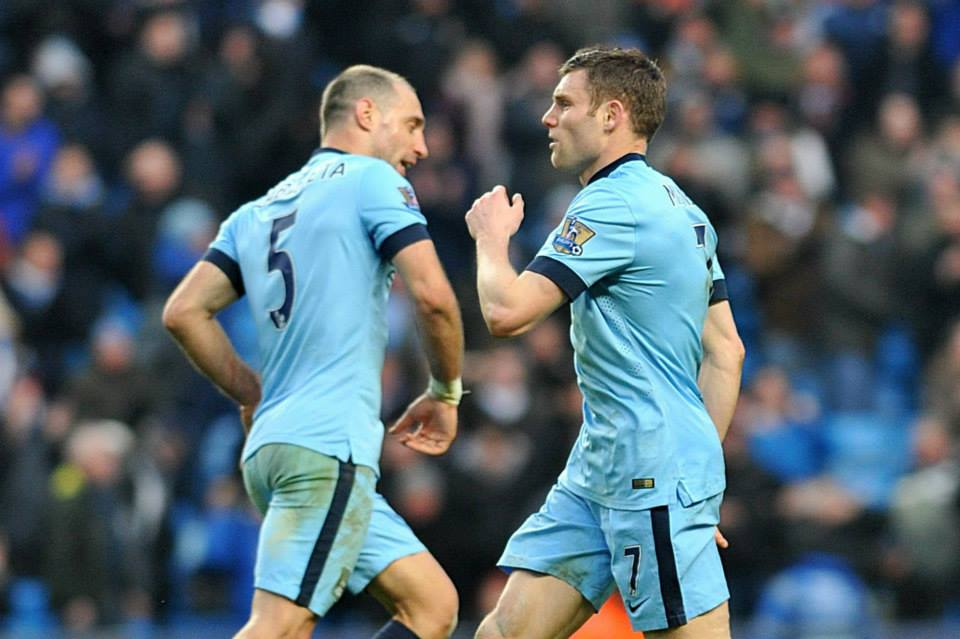 The Equalizer - James Milner has the briefest of goal celebrations with Pablo Zabaleta. Courtesy@MCFC