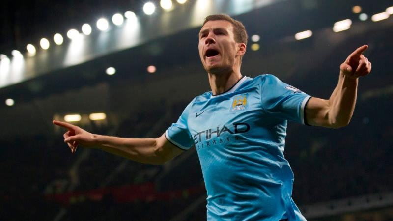 Same again - Edin Dzeko celebrates one of his brace of goals at Old Trafford last season. Courtesy@MCFC