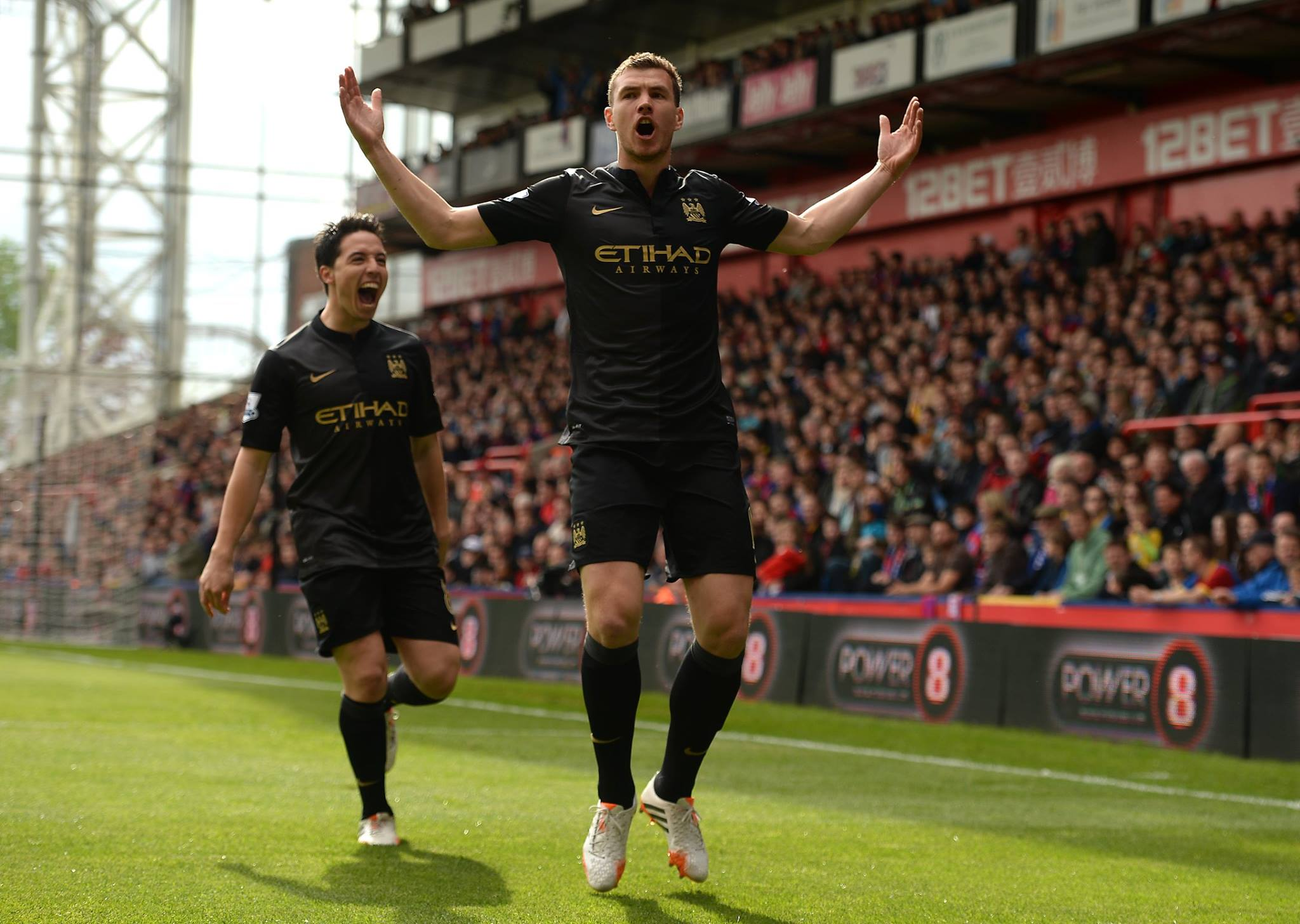 Happier times - Dzeko and Nasri celebrate during City's 2-0 win at Palace last season. Courtesy@MCFC
