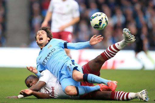 Silva scythed - David was 'cleaned out' by the Villa's Okore, but ref Mike Dean thought otherwise. Courtesy@MCFC