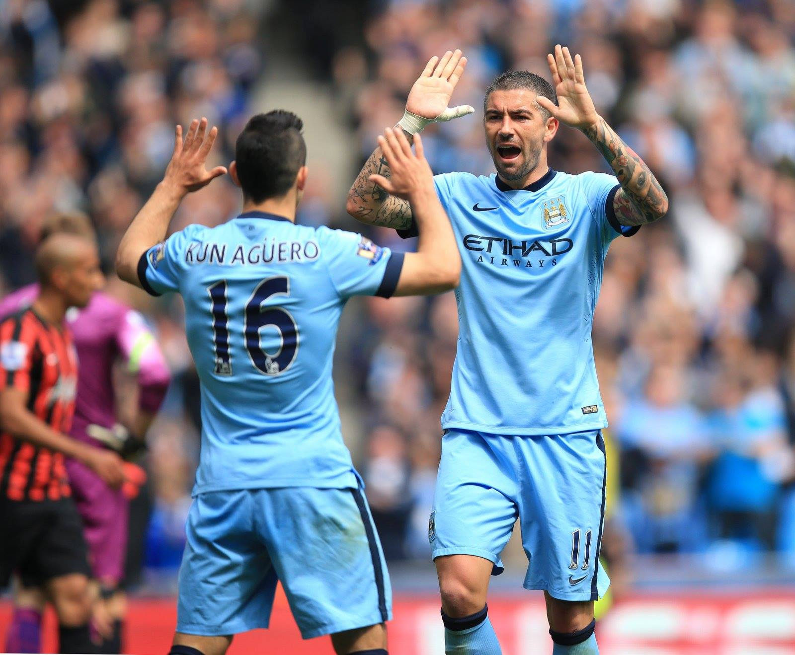 Familiar one-two - Aguero and Kolarov celebrate scoring for the second consecutive home game, during the 6-0 rout of QPR. Courtesy@MCFC
