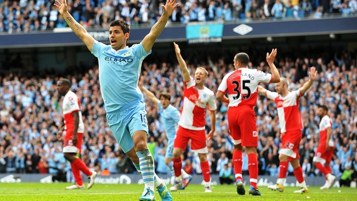 Against all odds - Sergio signals the beginning of the most dramatic & joyous celebration in the history of Manchester City.