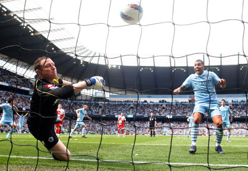 Tevez delight - Carlos watches on as Zabaleta puts City ahead.