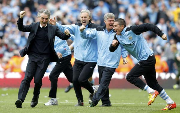 We've done it - Mancini and his men celebrate being Champions.