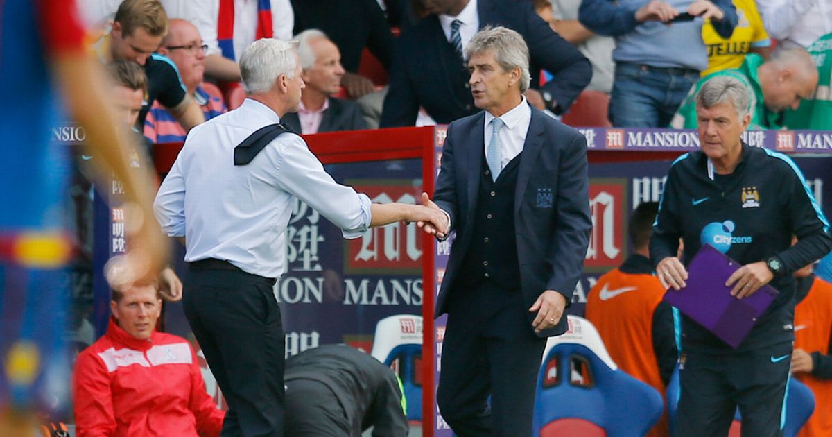 Peace? More like 'P*ss Off' - Manuel clearly dislikes Potty Mouth Pardew, but appears to accept a handshake of apology.