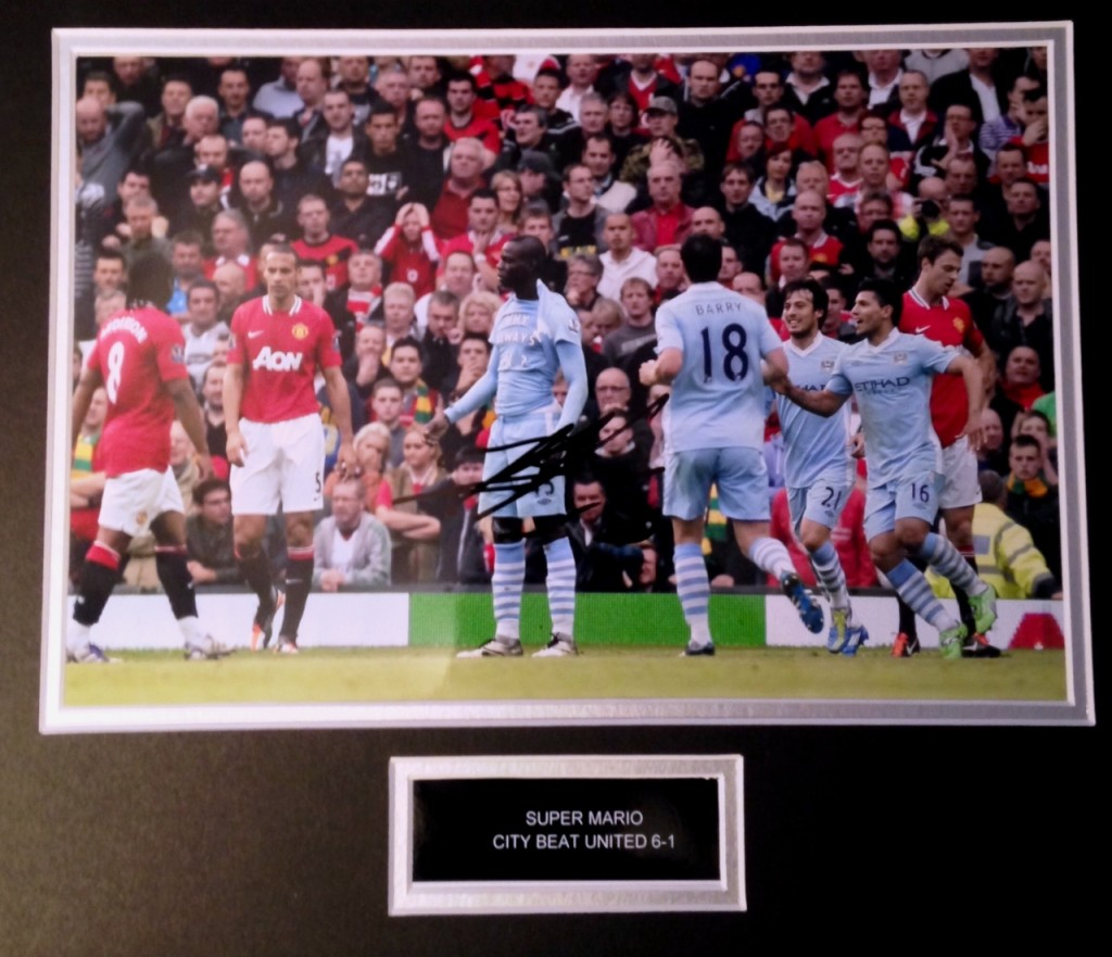 Win this Mario Balotelli signed photo as he began the famous 'Sick Swan' for City against United.