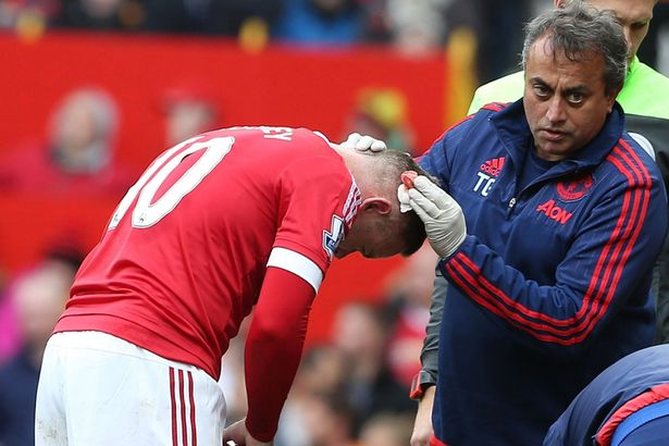 Can you see the join? Rooney's 'syrup' stayed on as his head was stapled after coming off worse in a clash with Kompany.