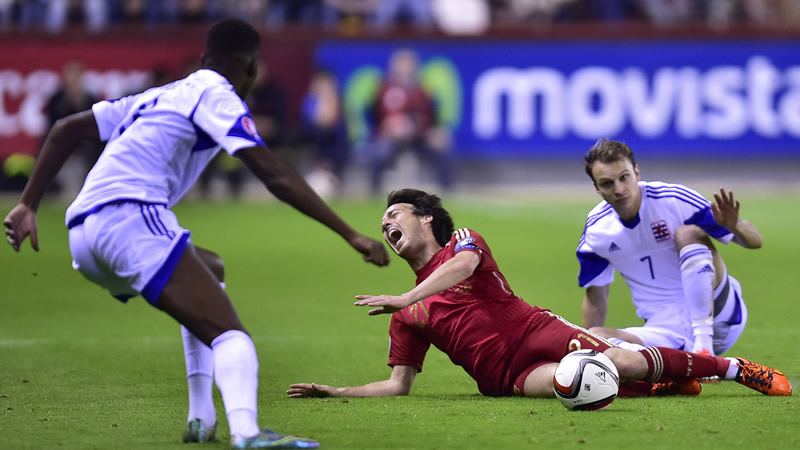 Crocked - David Silva is 'assaulted' by a hideous tackle in Spain's Euro 2016 qualifer.