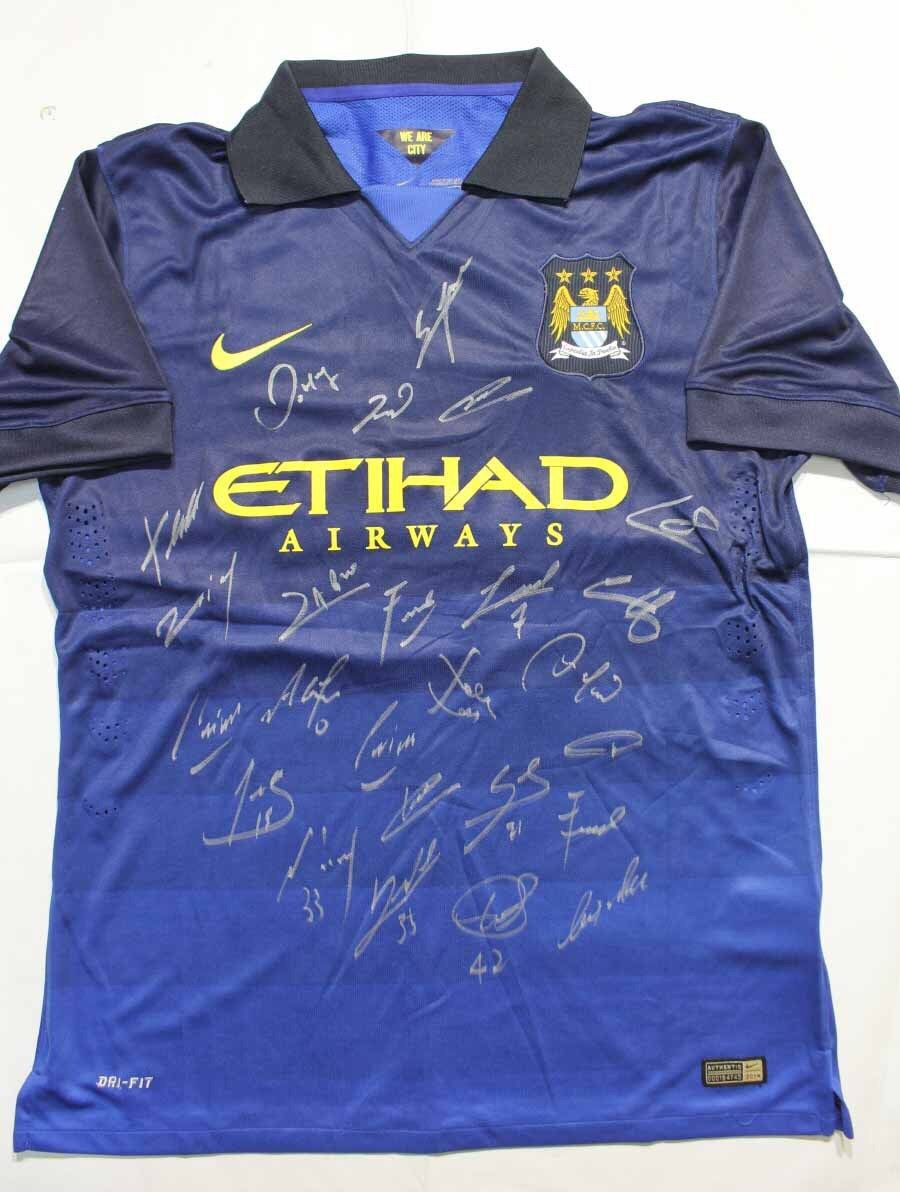Fraud - Chris Spencer tried to sell this Manchester City shirt complete with fake signatures - for £200.