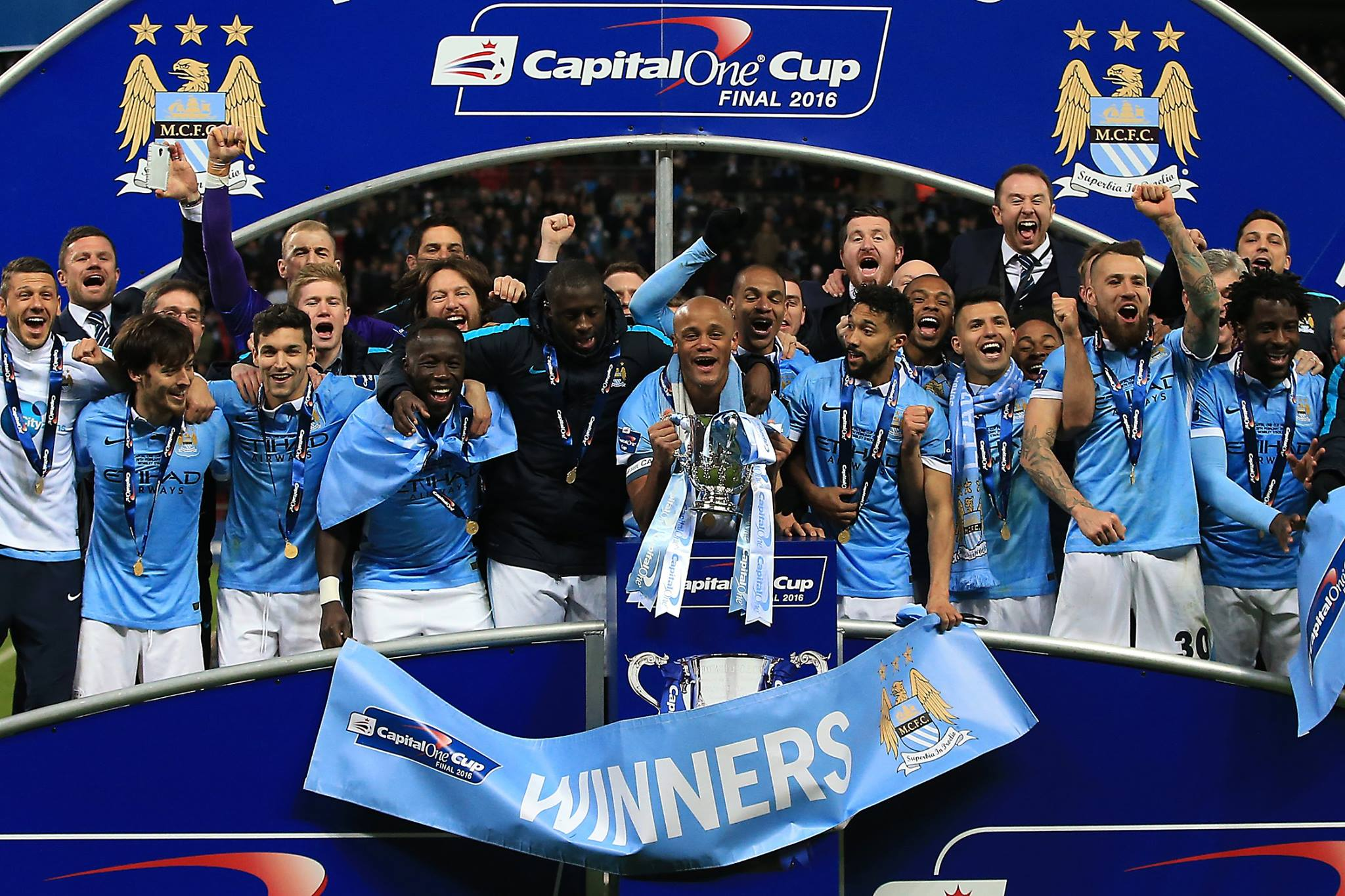 Winners - Sterling and City won the League Cup last season against Milner's Liverpool.