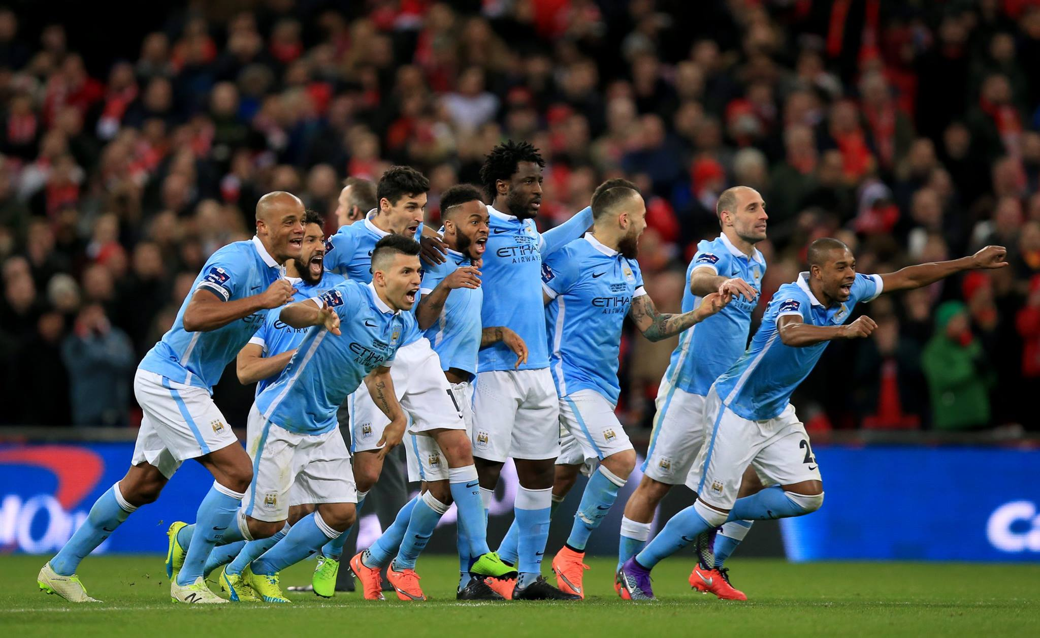 That moment when you've just won the Cup - City's players set off to congratulate Yaya and Willy. Courtesy@MCFC