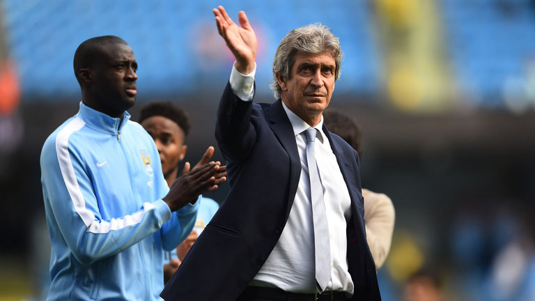 Bye bye and adios - Manuel waves farewell to just 5,000 remaining City fans at the Etihad...Yaya isn't far behind him!