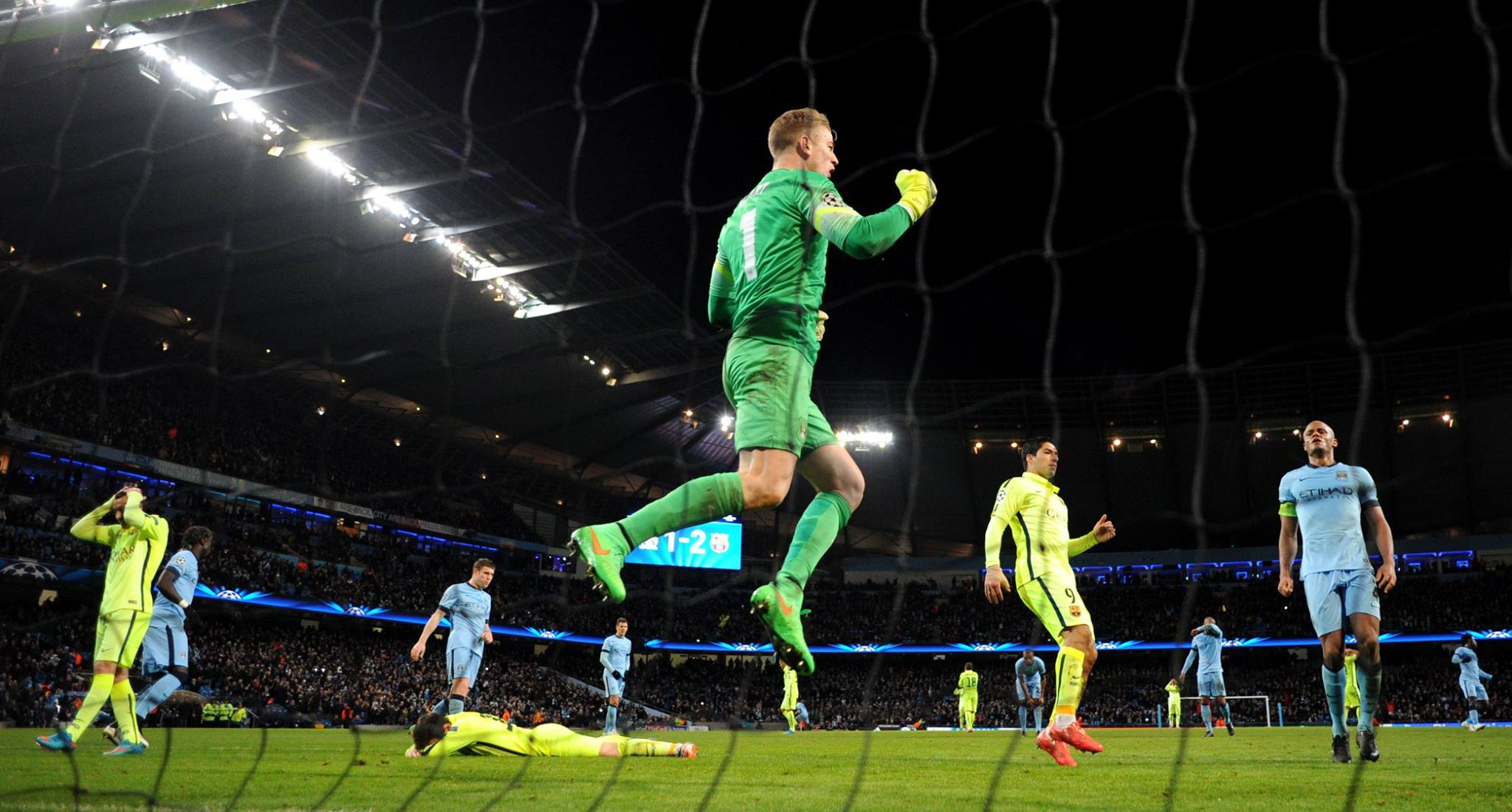 Jumping for joy - Joe saves Lionel Messi's penalty but it wasn't enough to help City overcome Barcelona in 2015.