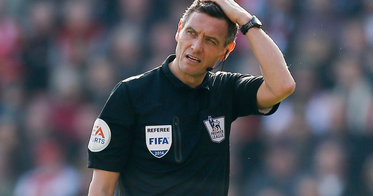 Head-scratcher and visually impaired - Marriner possibly wondering where he left his guide dog before kick-off at White Hart Lane.