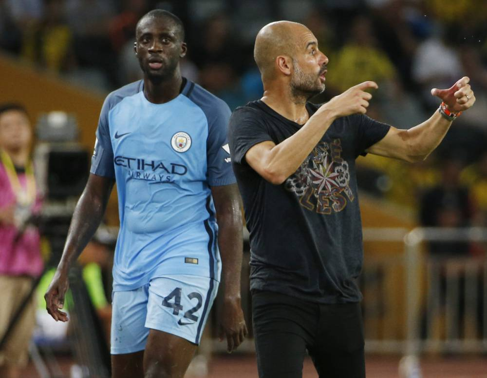 He's behind you - Pep has banned Yaya from playing for City until the Ivorian and his agent apologise for disrespecting City.