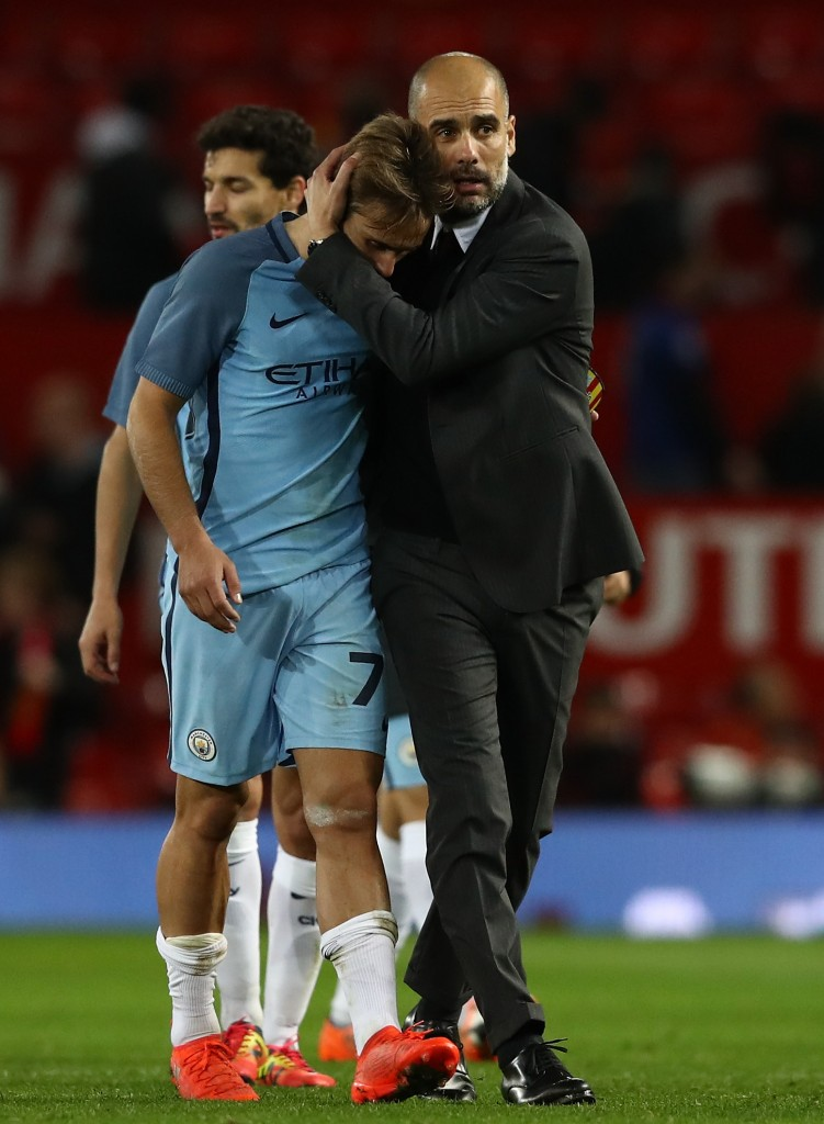 Guiding hand - Guardiola consoles young Alexi Garcia after the EFL loss at The Swamp.