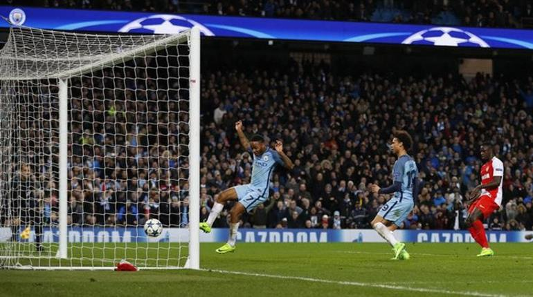 Don't touch it - Raheem avoids contact with the ball as Leroy steers home City's fifth goal.