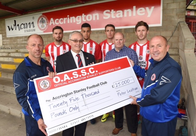 Community effort - the Official Accrington Stanley Supporters Club raised £25,000 last season and are doing the same in 2016/17. Peter Leatham (centre) presents the cheque to Stanley manager John Coleman (far right) and his assistant Jimmy Bell.