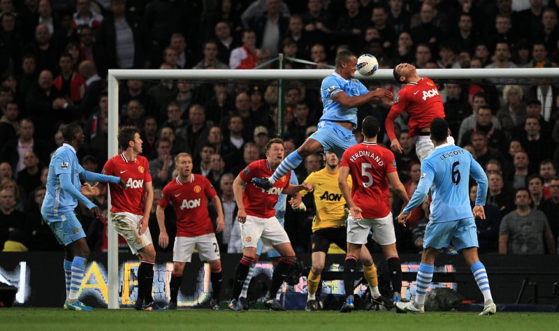 Captain Kompany rises high to score the winning goal which secured a 1-0 win over United and a Premier League double in 2011/12.